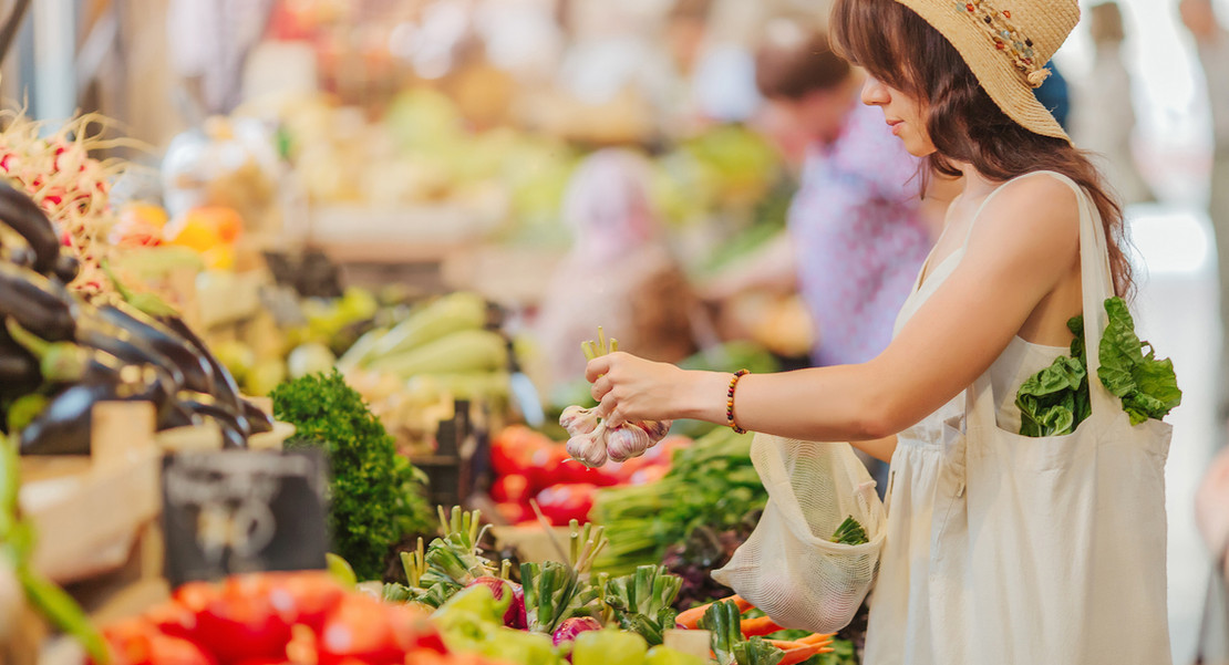 Woman Buying Vegetables