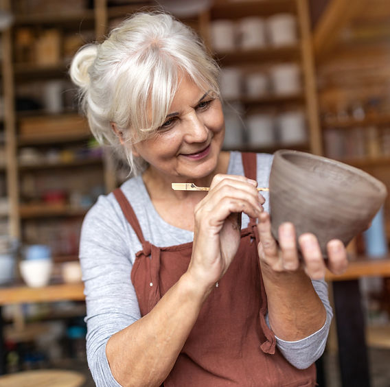 Woman working on her pottery