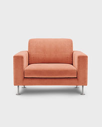 an empty soft orange easy chair