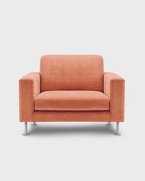 an empty soft orange easy chair