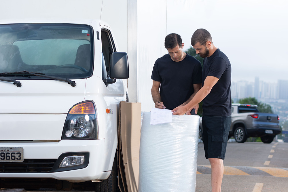 Professional moving company employees working