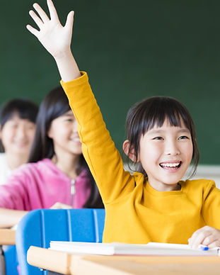 Top performer in Singapore raises hand in class to answer a question