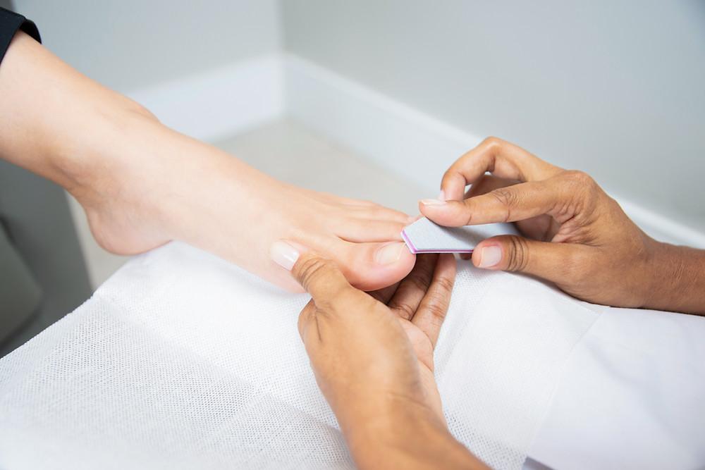 Person receiving a pedicure.