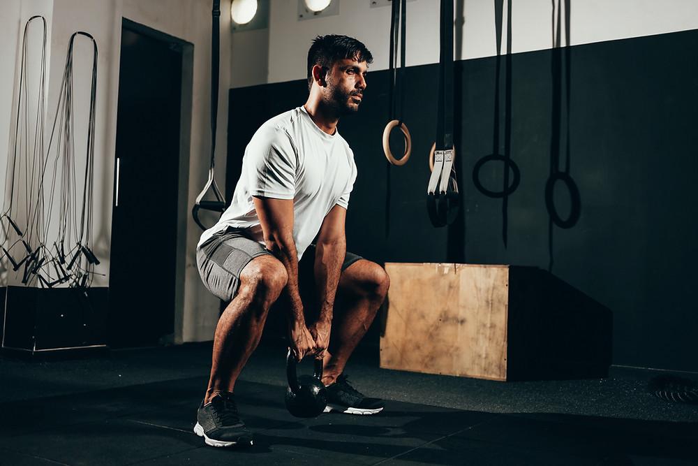 A man training in a gym.