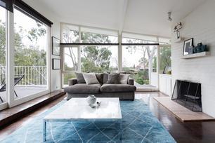 Sunroom with Blue Rug