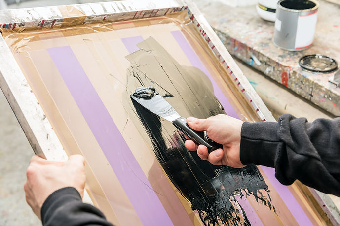 Close up of artist scraping paint