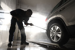 Man Cleaning Car