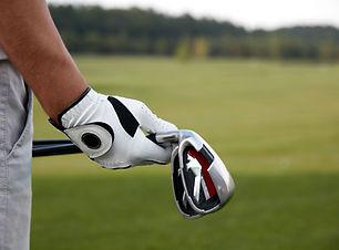 Golfschläger halten