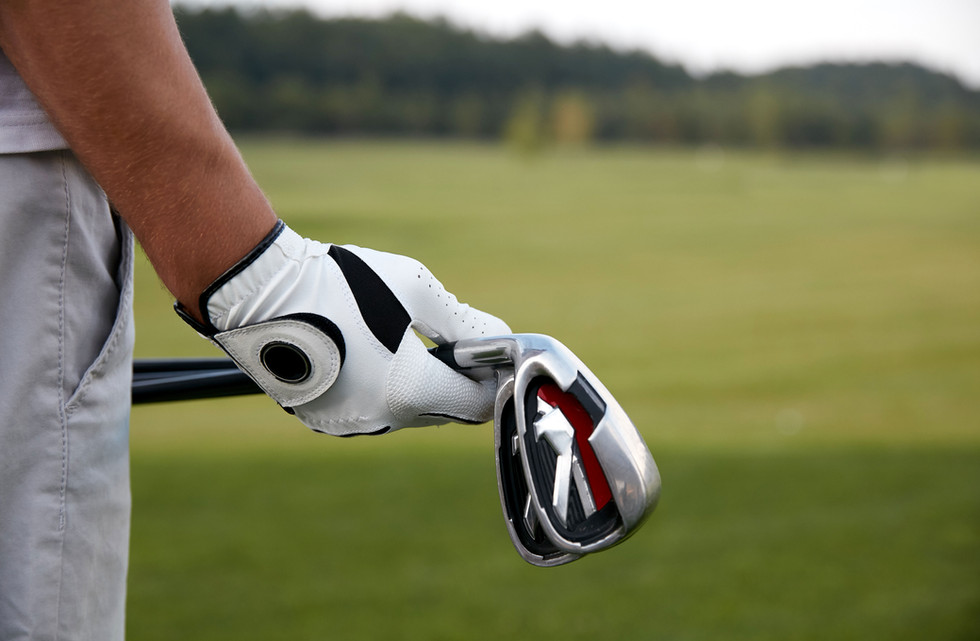Holding Golf Clubs