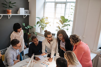 Team of multicultural people brainstorming together