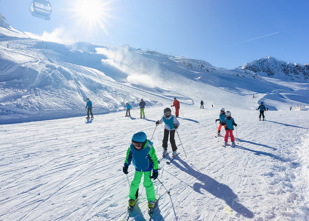 Children skiing safely with helmets
