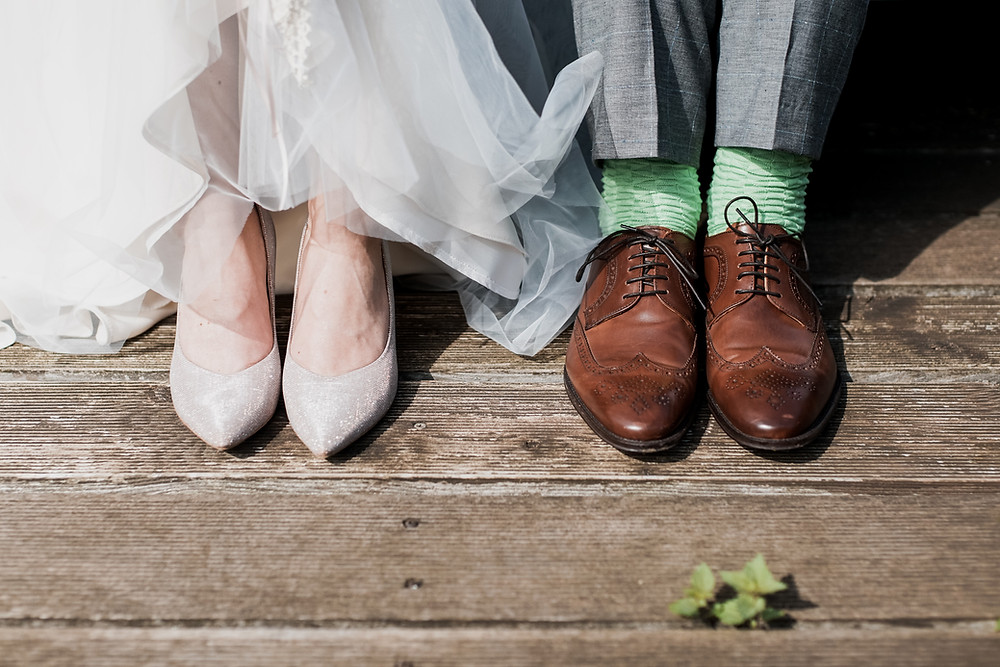 A close photo of the newlywed feets, made by photographer