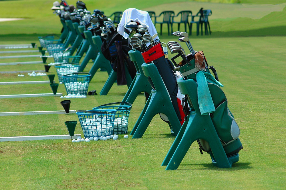 golf practice range.  Golf bags, clubs, and golf resort.