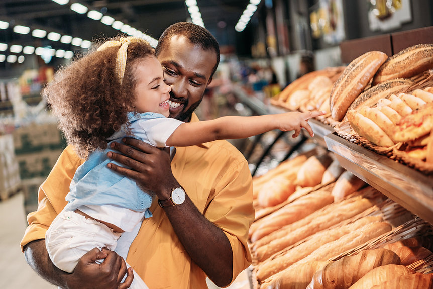 Family Buying Bread