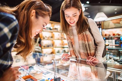 Women looking at merchandise