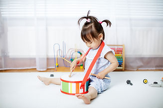 Toddler Playing Drums