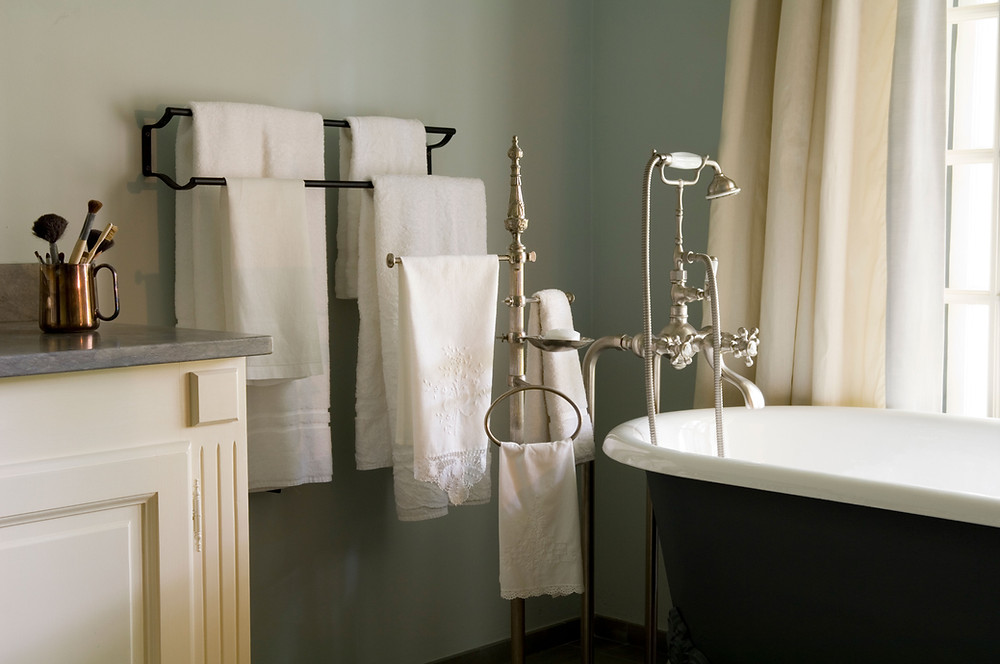 Elegant bathroom with a tub and hanging towels