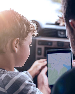 Father and Son Using GPS