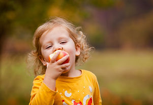 Cute Girl Eating Apple