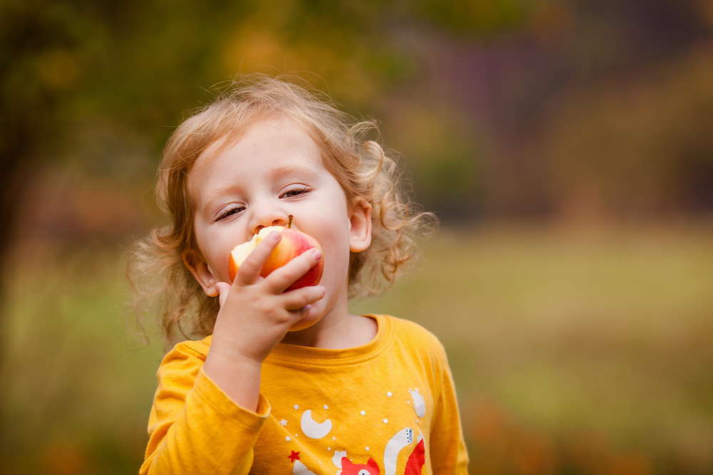A child eating and apple.