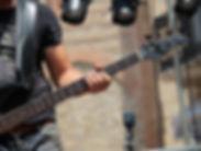 A Musician Playing Bass Guitar