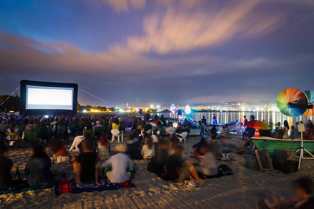 A Crowd Outdoors at a Waterfront Movie Night