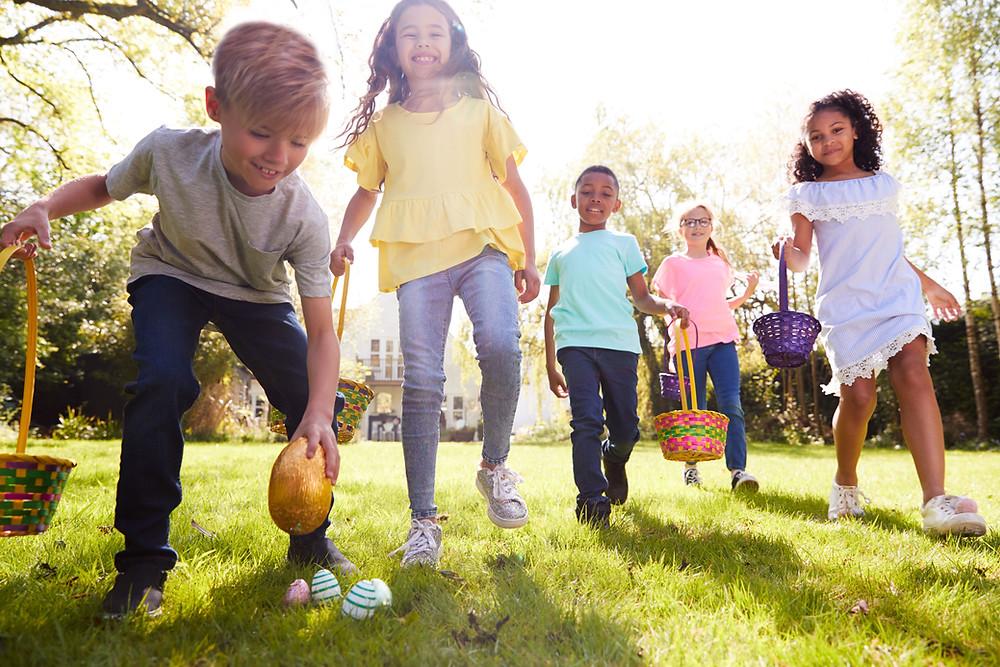 Kids hunting for Easter Eggs in the sunshine