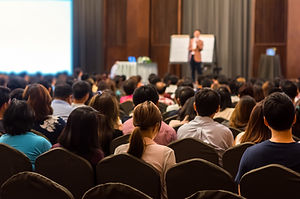A public speaker at a business conference