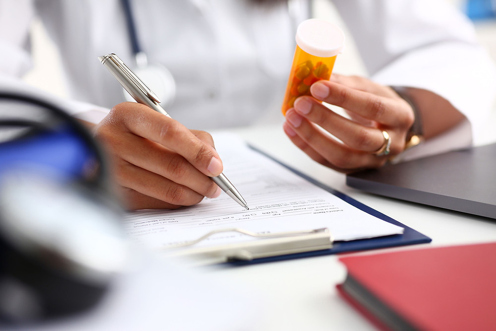 Doctor Filling Prescription