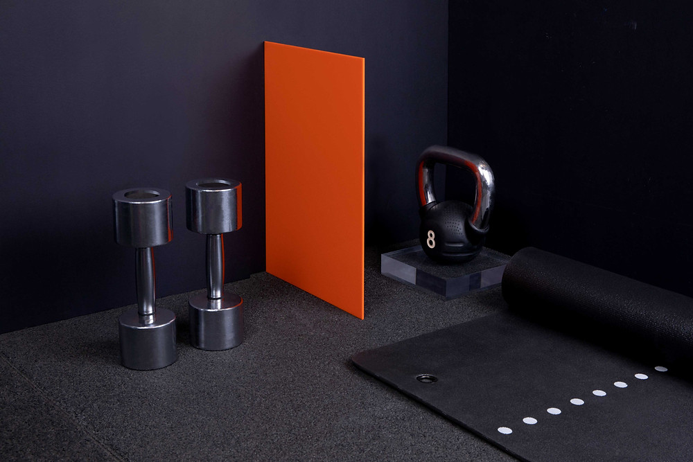 gym equipment with a orange spacer