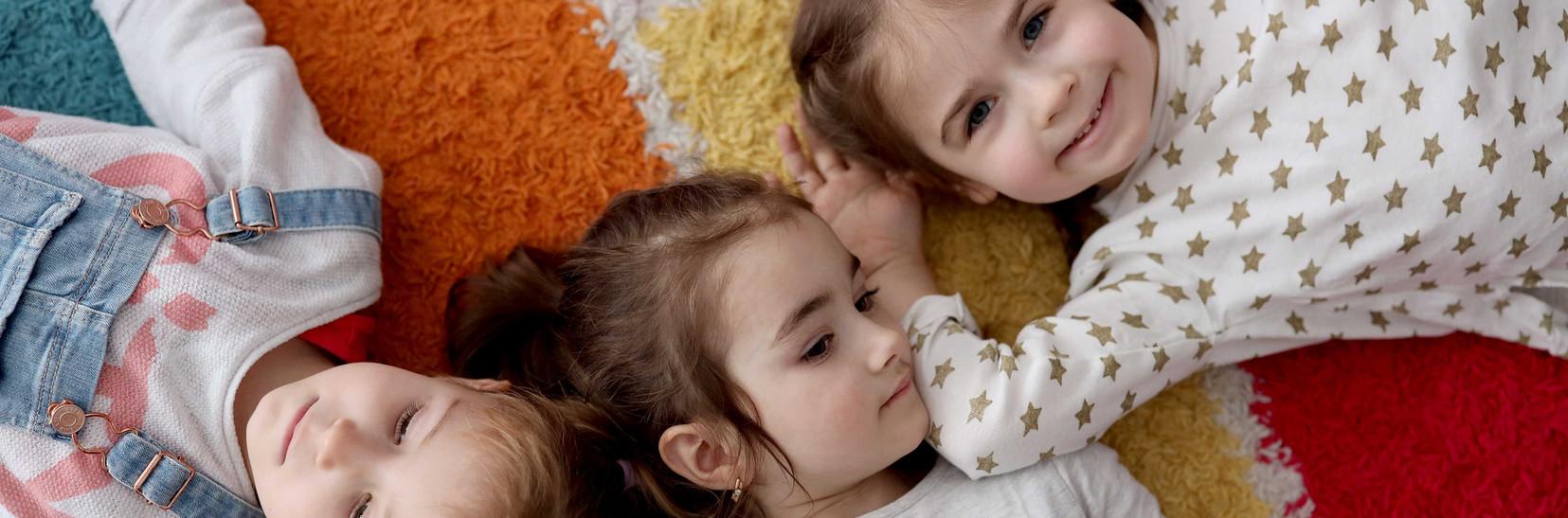 Girls relaxing on carpet