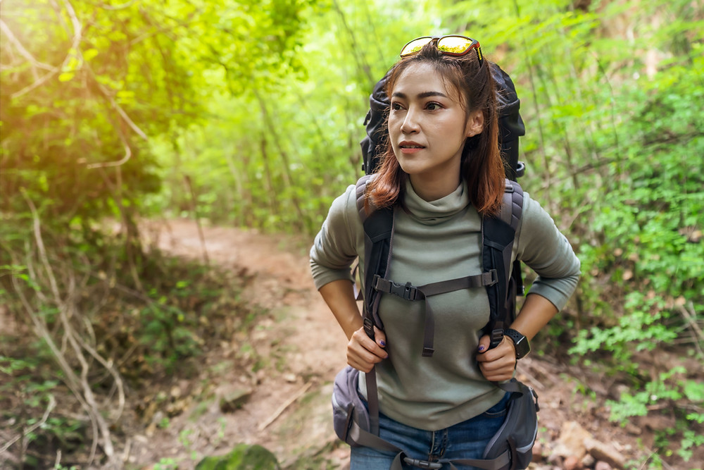 Woman hiking image - Pleasanton estate planning attorney discusses portability of a deceased spouse's unused estate tax exemption.