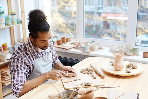 Man in Clay Workshop