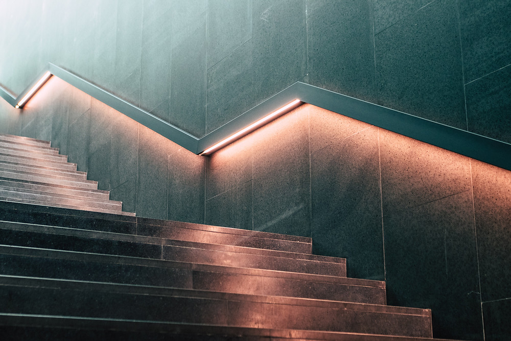 photo of dimly lit stairs representing scaling your collections team ability