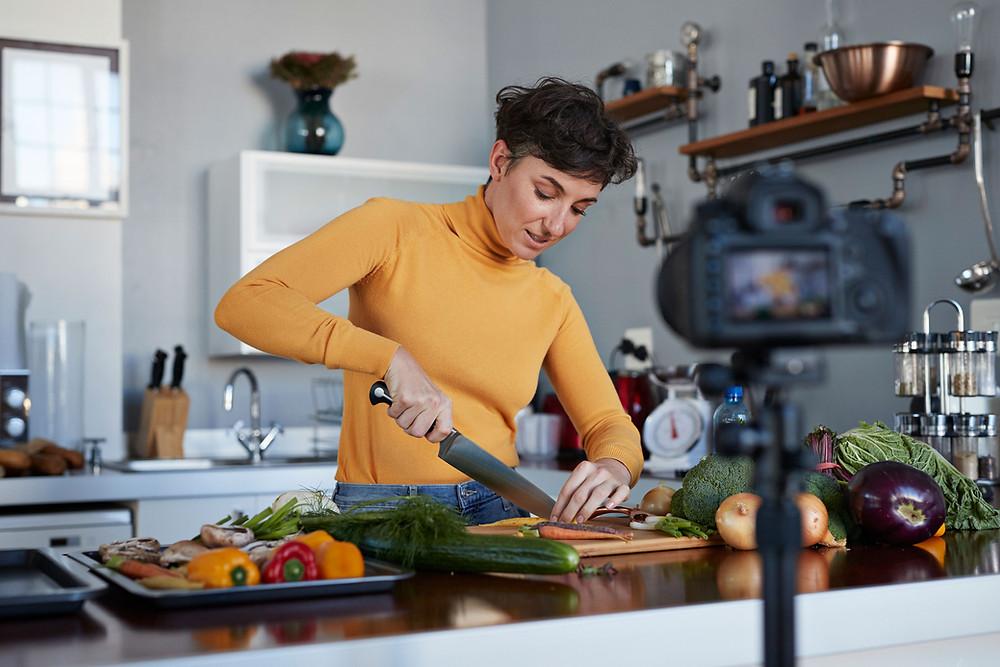 woman chopping vegetable