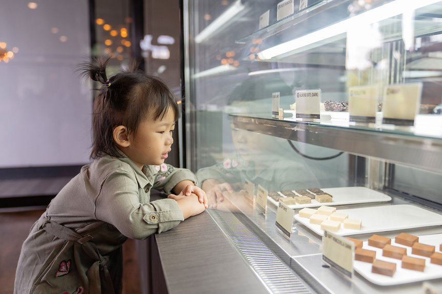 Little Girl Looking at Pastries