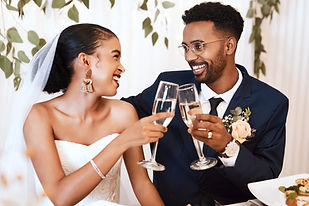 Bride and groom toasting with glasses