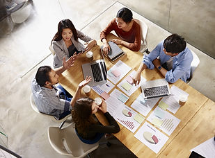 Five people sitting at a conference table | The Open Mind Institute