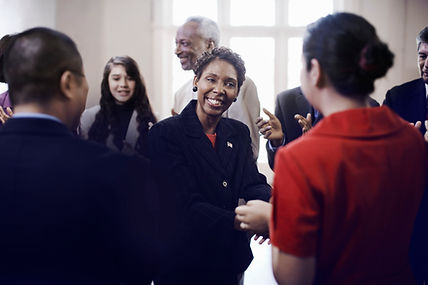 A woman smiling in a social gathering