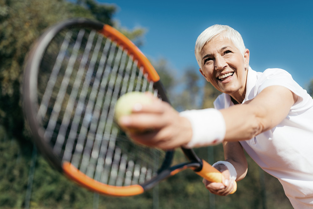Women playing tennis, fitness after 50