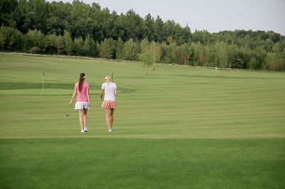 Rear View of female Golfers