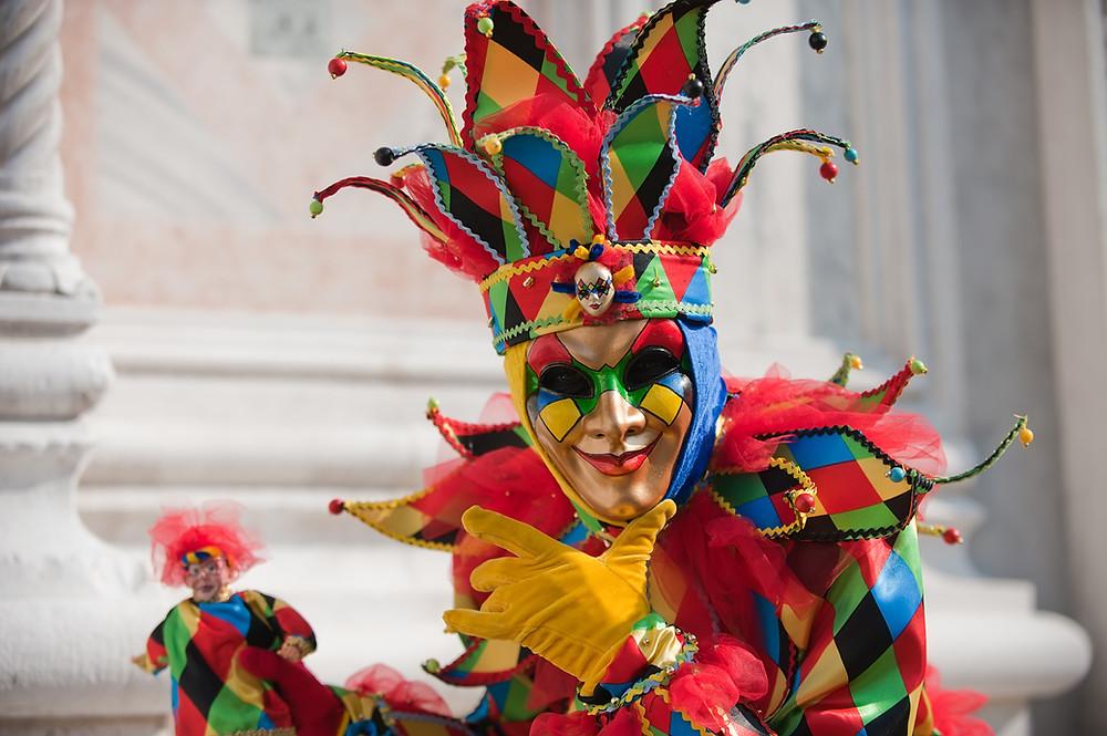 Fool in harlequin costume