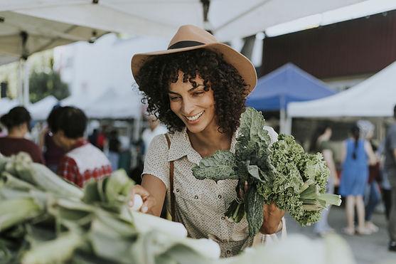 Woman Buying Kale