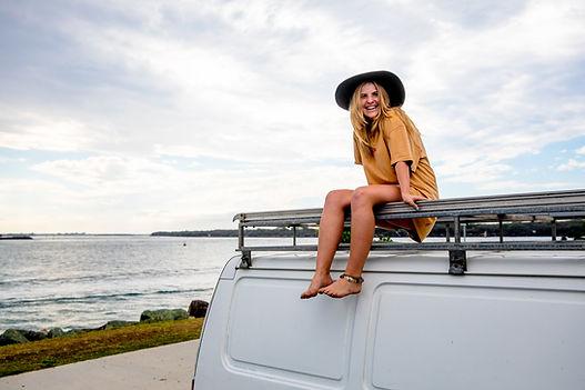 Woman on Van by Beach