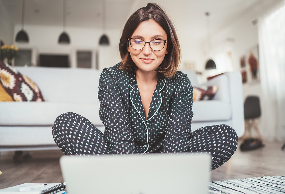 Woman executive working from home in pyjamas