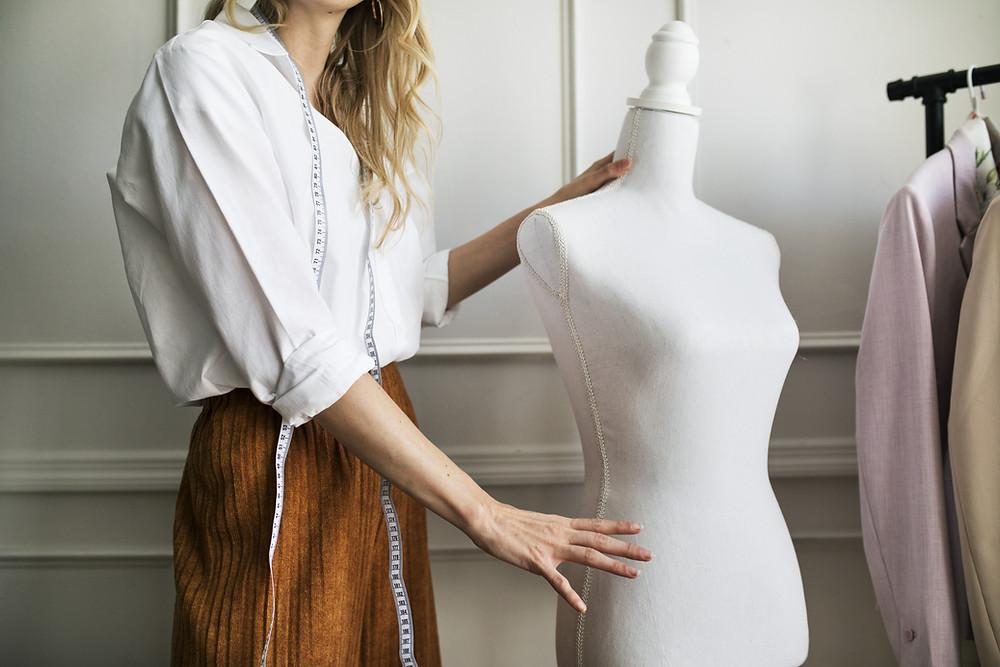 A fashion designer with mannequin