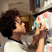 Man Sorting Bookshelf