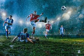 Match de football sous la pluie