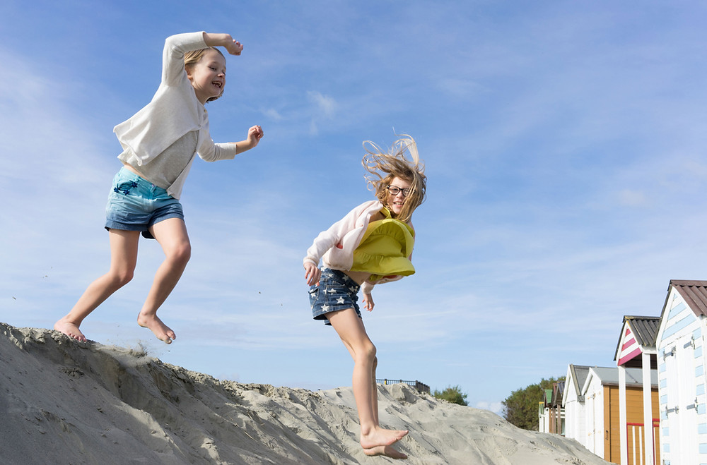 young children playing in sand