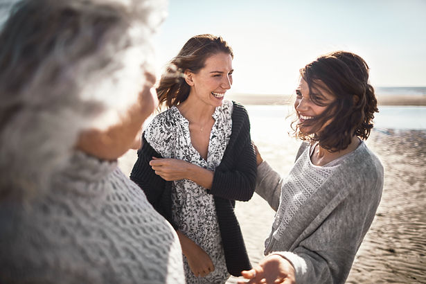 A group of laughing women by the coast